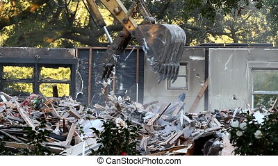 Home Demolished - Excavator bucket shove is used to pick up...