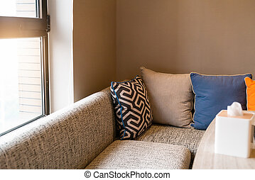 Home design interior, Cozy sofa on living room with colorful pillow.
