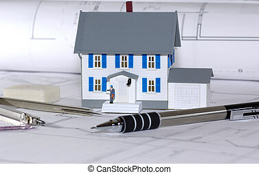 Home Design - Miniature House With Various Drafting Items...