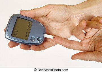Diabetes self-test - Home Diabetes self-test kit showing ...