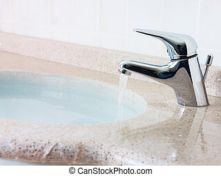 home disasters - water overflowing from washbasin. ...