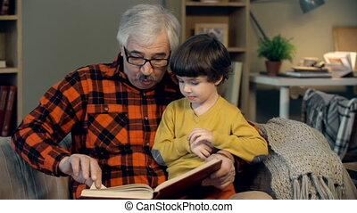 Home Education - Portrait of grandfather teaching his...