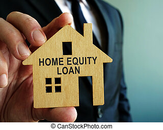 Home Equity Loan sign on a wooden model of house.