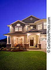 Home Exterior at Twilight - luxury home exterior with green...