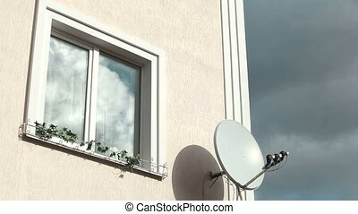 Satellite Television Dish - Home Exterior With Window Frame...