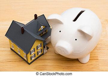Home Finances - Close up of a home with a piggy bank