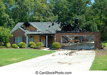 Home fire damage - Home destroyed by fire at a development...