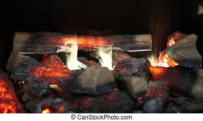 home fireplace full of wood and fire, imitation.
