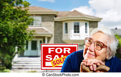 Home for sale and happy senior woman