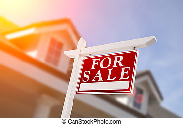 Home For Sale Real Estate Sign in Front of House