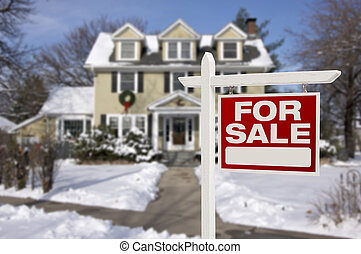 Home For Sale Sign in Front of Snowy New House