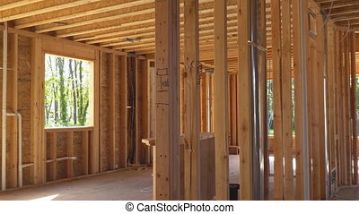 Home Framing unfinished wood frame building or a house -...
