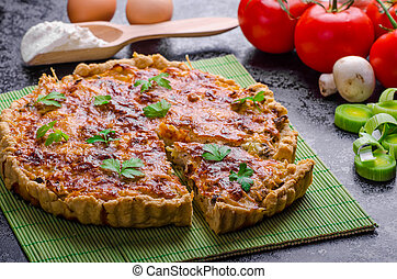 Home French quiche stuffed with mushrooms, tomato and leek
