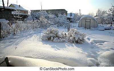 Home garden buried in snow. The landscape of the Ural winter.