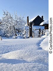 home garden covered with fresh and fluffy white snow, landscape of the Ural winter