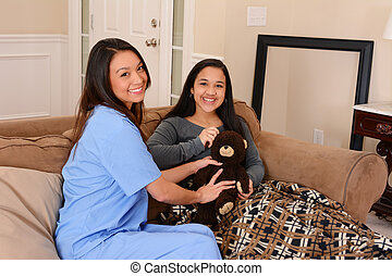 Home Health Care - Home health care worker and a teen girl