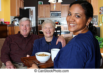 Home Health Care - Home health care worker and an elderly...