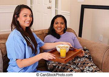 Home Health Care - Home health care worker and an adult...