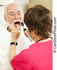 Home Health Checkup - Ahhh - Home healthcare nurse uses a...