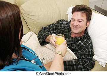 Home Health - Fluids - Man home sick taking a glass of...
