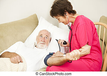 Home Health Nurse Takes Blood Pressure - Home health care...