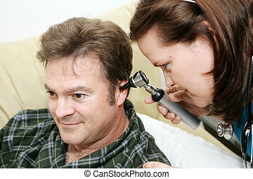 Home Health - Otoscope - Home health nurse using an otoscope...