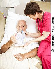 Home Health - Respiratory Therapy - Home health nurse uses...