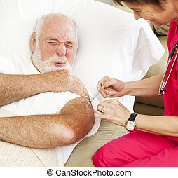 Home Healthcare - Painful Injection - Senior man gets a...
