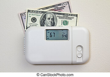 Home Heating Costs - In door heating thermostat set at a...