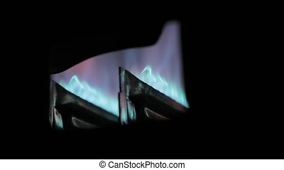 Home heating system gas flame - Gas burner flame inside a ...