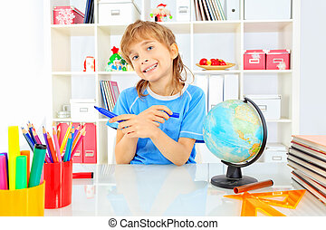 A boy doing his lessons at home.