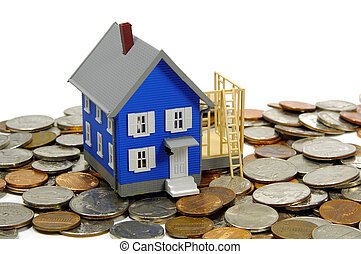 Home Imporvement - Miniature House On Top Of Money. Home...
