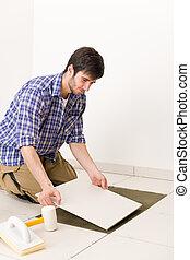 Home improvement - handyman laying tile - Home improvement, ...