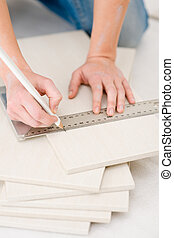 Home improvement - handywoman measuring tile