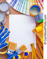 Home improvement paint tools and pantone fan on clean paper main