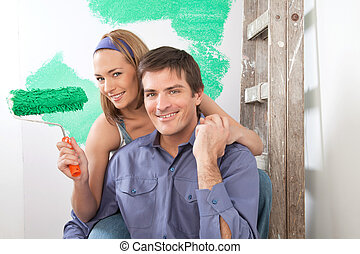 Home Improvement Painting - Beautiful young couple sitting ...