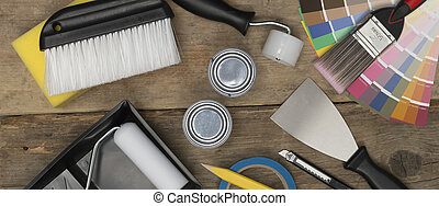 Home Improvement Painting Tools on Wooden Surface