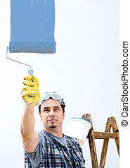Home improvement - Worker painting the wall.