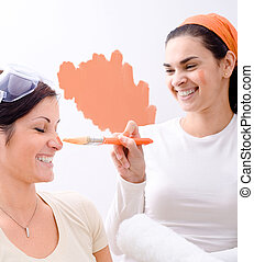 Home improvement - Young women (sisters) improving home.