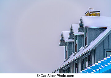 Home in Daybreak Utah with roof blanketed in snow