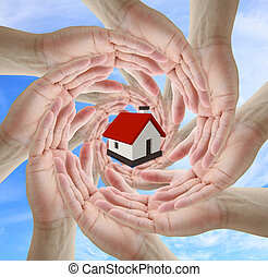 Home Insurance concept - A diverse business team holding...