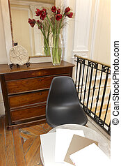 Home interior detail with chair and table.
