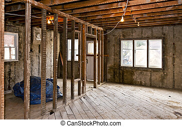 Home interior gutted for renovation - Interior of a house...