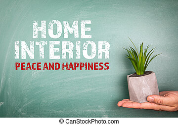 HOME INTERIOR, PEACE AND HAPPINESS. Plant in a flower pot. Green chalk board