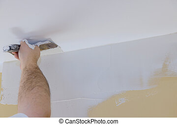 Home interior renovation on plastering wall coating putty plaster on the wall