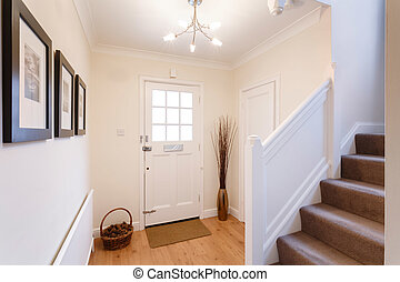 Home interior showing hallway and carpeted stairs