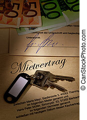 home keys and rental agreement - the key to an apartment and...
