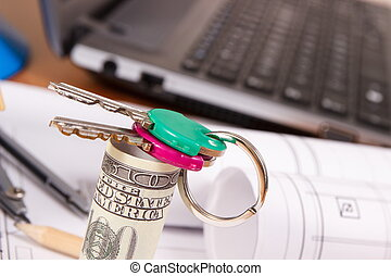 Home keys, currencies dollar and accessories for use in engineer jobs, building home cost concept