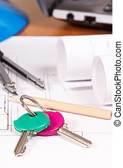 Home keys, electrical diagrams or blueprints and accessories for engineer jobs, building home concept