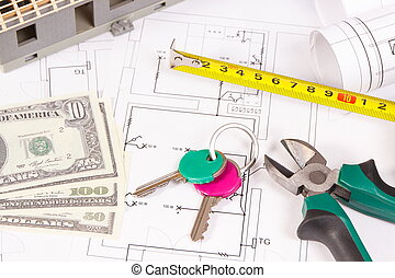 Home keys, money, electrical diagrams and work tools for engineer jobs, building home cost concept